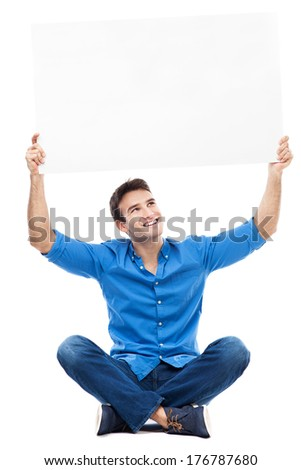 Young man holding sign above his head   - stock photo