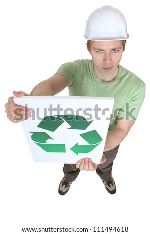 Young man holding sign with symbol of recycling - stock photo