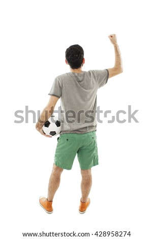 Young man holding soccer ball in hand looking at wall. Rear view. Isolated on white background - stock photo