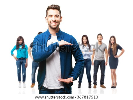 young man holding something - stock photo