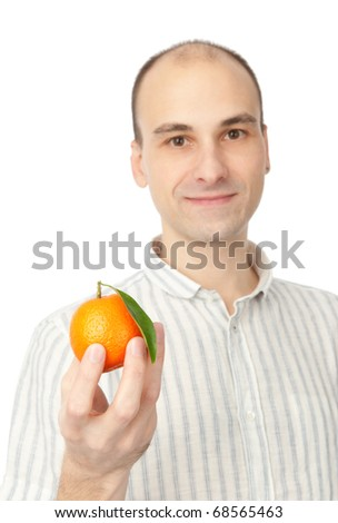 young man holding tangerine