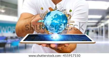 Young man holding the planet earth surrounded by famous monuments of the world over his digital tablet '3D rendering' - stock photo