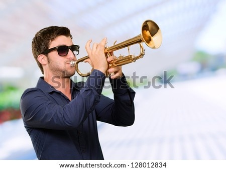 Young Man Holding Trumpet, Outdoor - stock photo