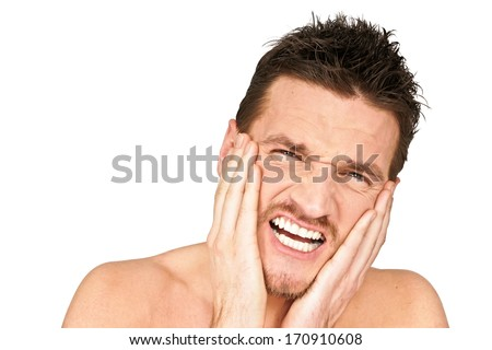 Young man holding your face because suffering from a toothache - stock photo