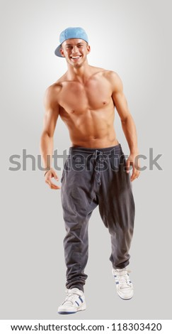 young man in a blue cap dancing hip hop - stock photo