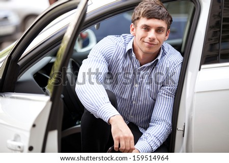 Young man in a car - stock photo