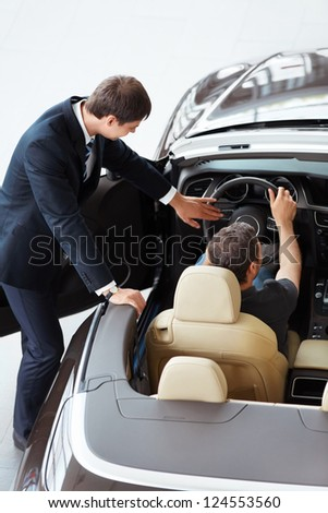 Young man in a convertible - stock photo