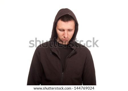 Young man in a hoodie looking down - stock photo