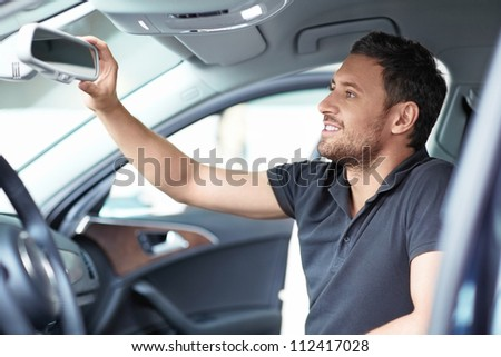 Young man in a inside the car - stock photo