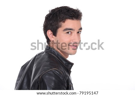 Young man in a leather jacket - stock photo