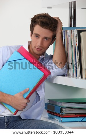 Young man in a library - stock photo