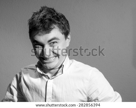 young man in a light shirt with open collar. wicked - stock photo