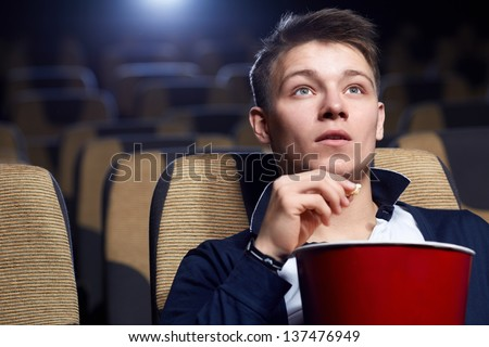Young man in a movie theater