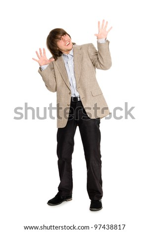 Young man in a panic mood waving his arms. - stock photo
