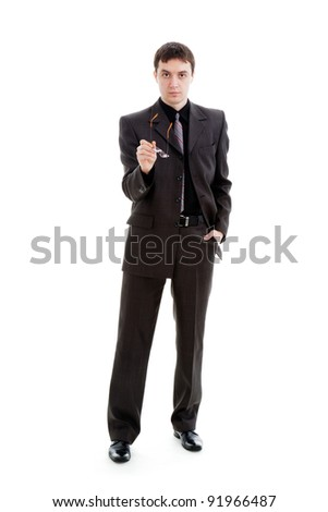 young man in a suit holding a glasses, isolated on a white background.