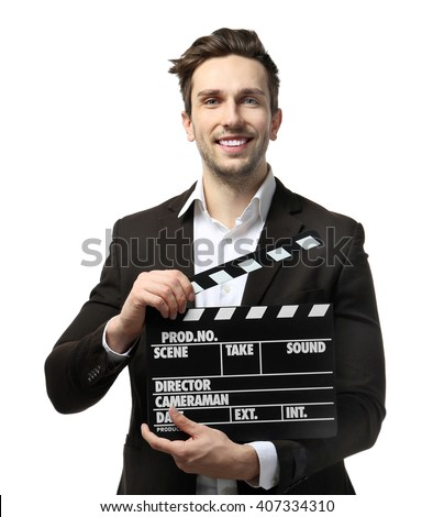 Young man in a suit holding a movie clapperboard, on white background - stock photo