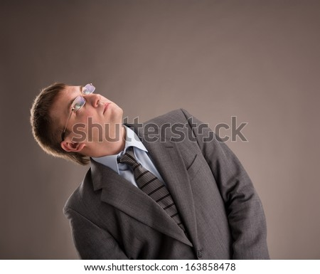 Young man in a suit looking up - stock photo
