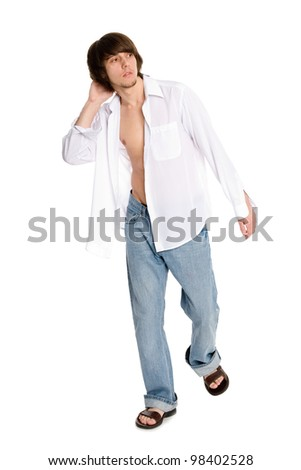 young man in a white shirt in the full length - stock photo