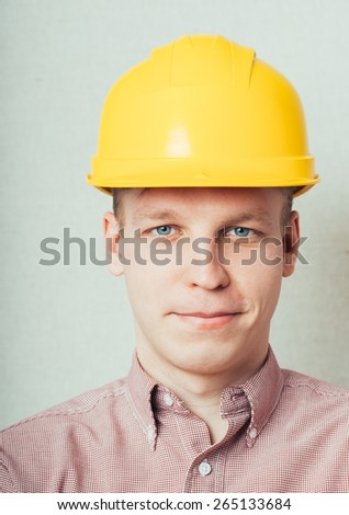 young man in a yellow helmet