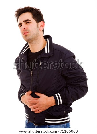 Young man in agony suffering stomach pain in white background