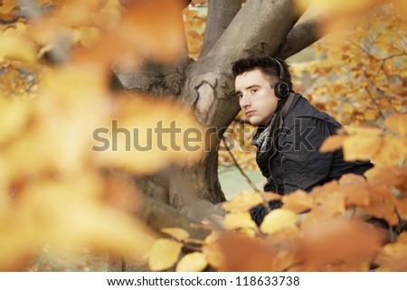 Young man in autumn park