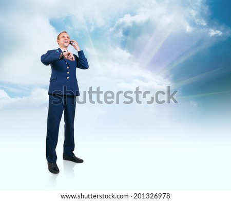 Young man in aviation uniform  over blue sky background