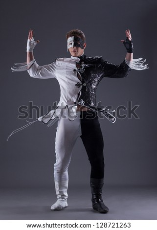 young man in black and white fancy dress