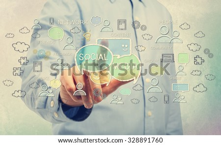 Young man in blue shirt pointing at social media concepts - stock photo
