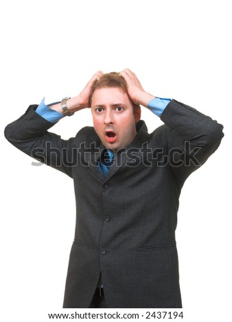 Young man in business suit holding his head with hands with a panic expression on his face isolated on white - stock photo