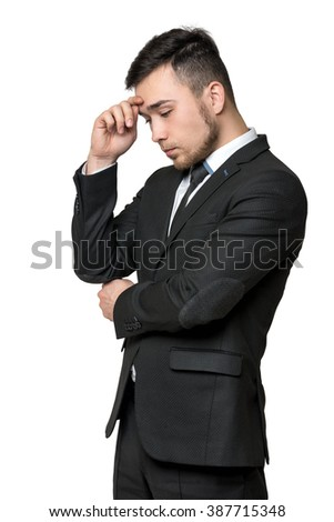Young man in business suit, thinking about something, isolated on a white background