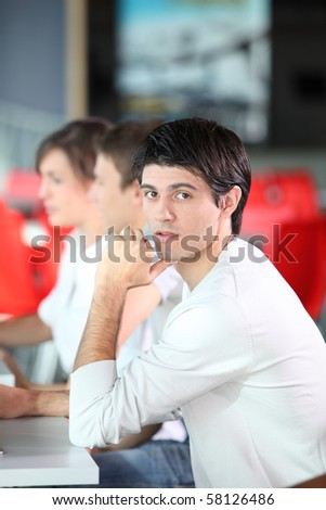 Young man in business training