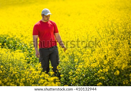 Young Man in Canola Field