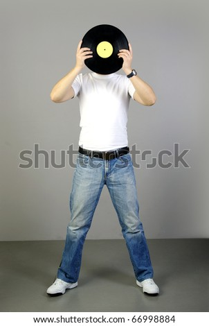 young man in casual holds an old plate before person - stock photo