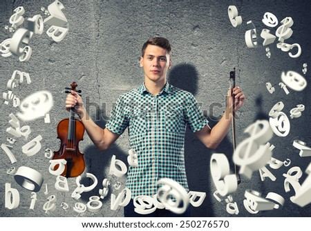 Young man in casual on cement background playing violin