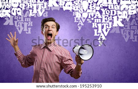 Young man in casual screaming in megaphone - stock photo