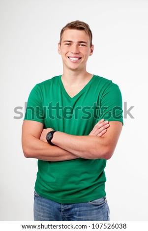 Young man in casual wear standing with crossed arms Isolated on white background - stock photo