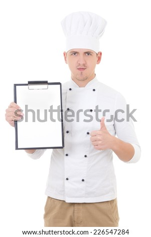 young man in chef uniform thumbs up and showing clipboard with copy space isolated on white background - stock photo