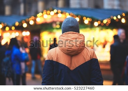 Young man in christmas market, Vienna, Austria