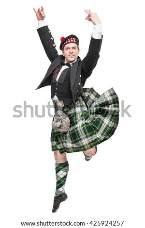 Young man in clothing for Scottish dance isolated