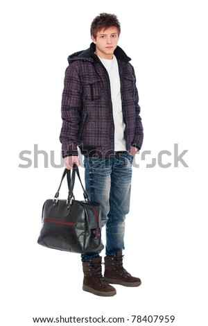 young man in coat holding bag. isolated on white background - stock photo