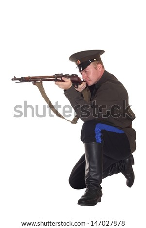 Young man in Cossack clothes with Mosin rifle - stock photo