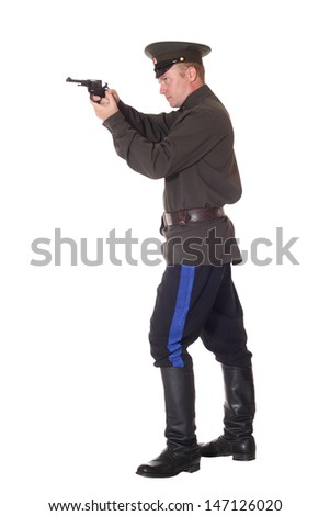 Young man in Cossack clothes with revolver