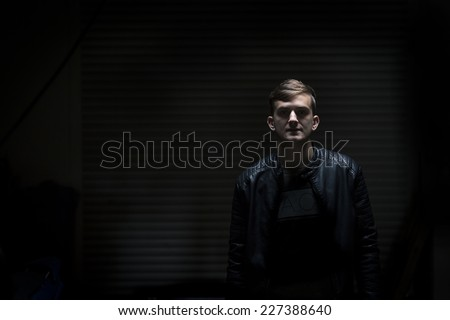 young man in dark garage