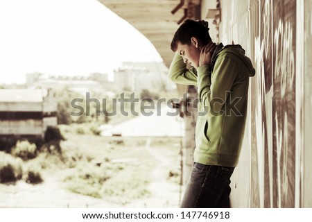 Young man in depression - stock photo