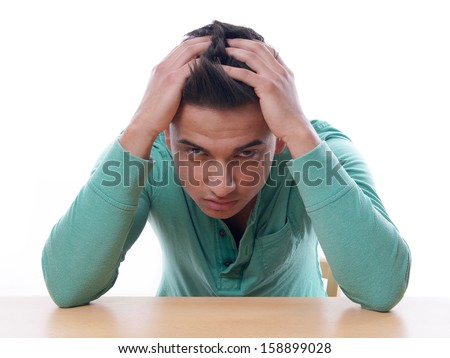 young man in despair - stock photo