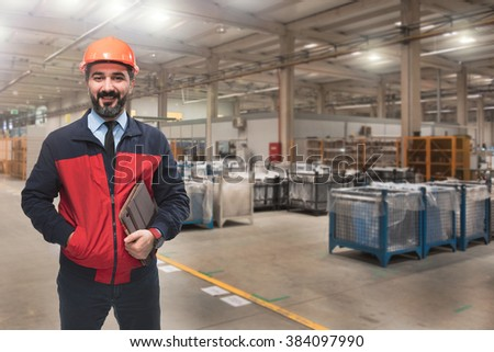 Young man in factory. - stock photo