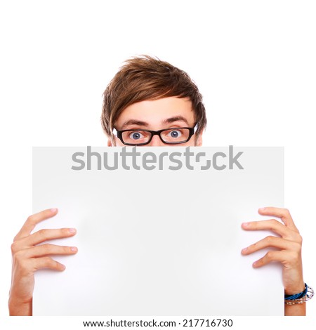 Young man in glasses holding a sign - stock photo