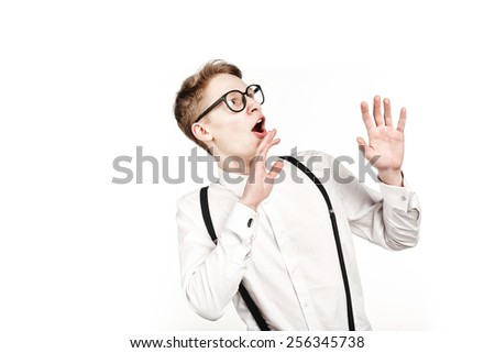 young man in glasses surprises and shock on white background