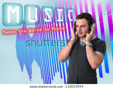 Young man in grey t-shirt listening to music with earphones - stock photo