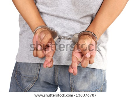 Young man in handcuffs